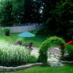 residential, softscape, hardscape, play area, vined arbor, stone retaining wall, stepping stone walk, screened relaxation area