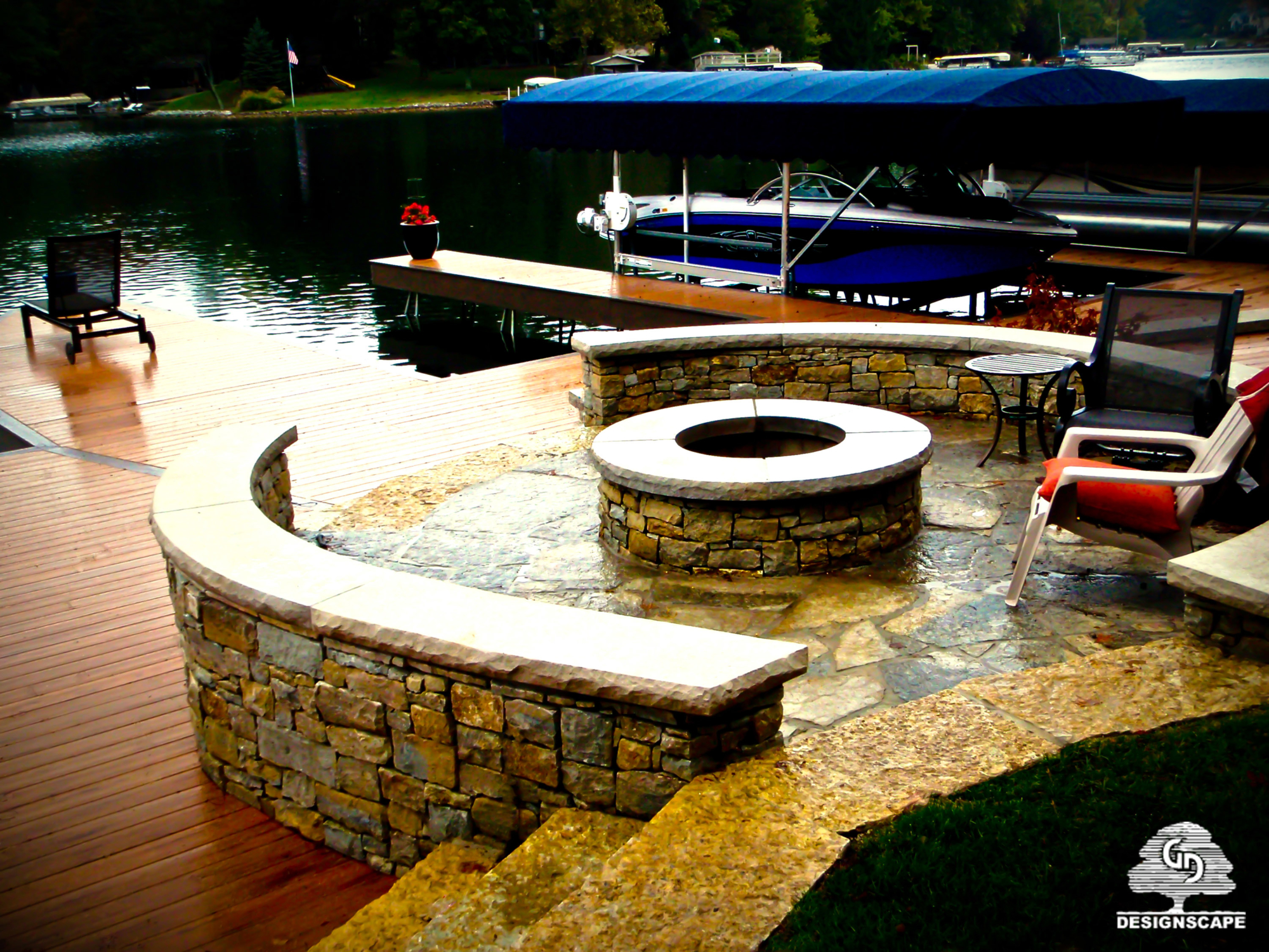 hardscape, lakeside, seatwall, stone wall, dock incorporated design, gathering space