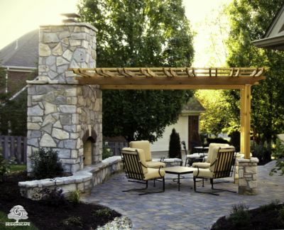 hardscape, outdoor living area, stone fireplace, residential, pergola, pavers